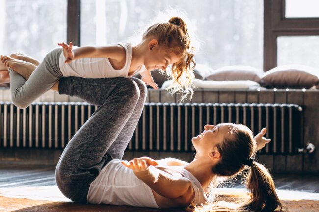 Mum doing yoga with her daughter